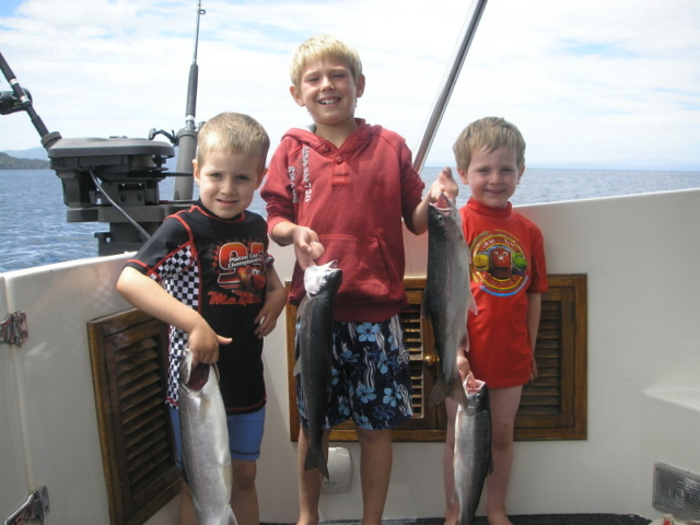 Boys with trout at lake taupo